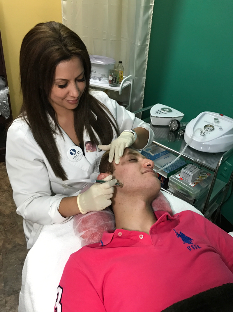 Ivette working with a client at the spa